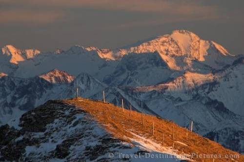Snowcapped Austrian Alps At Sunset